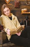Study concept. Girl student study with book in house of gamekeeper. Girl in casual outfit sits with book in wooden. Vintage interior. Lady on calm face in plaid stock images