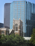 A study in contrast. Old church with new glass building in background Stock Photo
