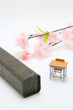 Study desk, diploma, and cherry blossoms on white background. Royalty Free Stock Photos