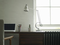Study Desk With Laptop And Lamp Stock Photography