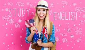 Study English text with young woman with flags stock images