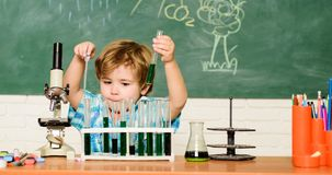Study grants and scholarship. Boy performing chemistry test. Wunderkind and early development. Small pupil learn royalty free stock photo