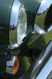 Study in Green, Orange, Chrome and Glass. Study of Headlamp, parking lamp and fender of antique automobile Stock Photo