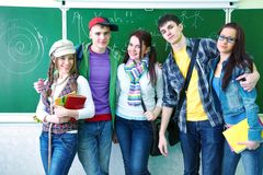 Study group in classroom. Portrait of six teens in classroom background green board Stock Images