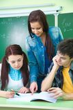 Study group in classroom Stock Photo