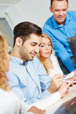 Study group in college with teacher. Study group learning in college with a teacher royalty free stock images