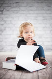 Study hard. Cute baby girl with book Stock Image