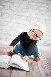 Study hard with nerd glasses. And hat Royalty Free Stock Image