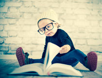 Study hard with nerd glasses. And hat Royalty Free Stock Images