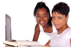 Study help. Adolescent helps mom with her homework Stock Photos