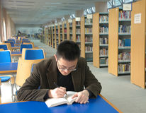 Study in library. Asian student study in library Royalty Free Stock Images