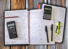 Study materials. Calculators, pens, pencil and highlighter on ancient wooden table Royalty Free Stock Photos