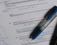Study notes university. Finance school materials with pen and insurance annuity&#x29 stock photo