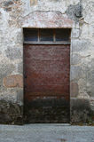 A study of an old wooden door. A study of old wooden doors set with old stonework Royalty Free Stock Images