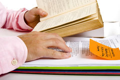 Study and Research. Man Reading books and documents for Study and Research Stock Photos