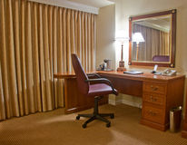 Study room with armchair lamp and mirror Stock Photos