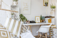 Study room with hammock. White cozy study room with white desk and hammock with pillows royalty free stock photo