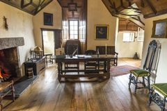 A study room with a large desk and writing accessories inside of Crathes Castle stock photos