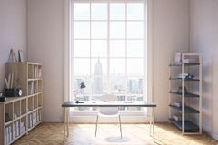 Study room in New York. Study room interior in modern New York City. Writing table with desk lamp. Two shelves by sides of premises. Large window. Concept of Stock Photo