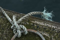 Study of Rope and Knot. Study of  Rope and a Marine bollard., Nautical Mooring. Coloured rope Royalty Free Stock Image