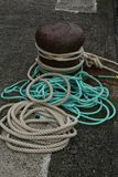 Study of Rope and a Marine bollard. Study of multiple Rope and a Marine bollard., Nautical Mooring. Coulred rope Stock Photography