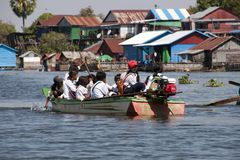 Children going to school by boat royalty free stock images