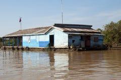 Tonle Sap Lake, traditional houseboat on tributary stock photo