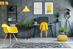 Study space with metal furniture. Study space with concrete walls and yellow and metal furniture royalty free stock image