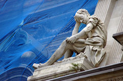 Study in stone. Statue of a greek philosopher studying Royalty Free Stock Images