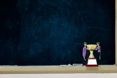 Received many trophies put on a blackboard royalty free stock photography