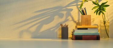 Free Study Table With Copy Space, Stationery, Books, Elements And Plant Vase Royalty Free Stock Photography - 196821817
