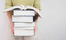 Study time. Student carrying a stack of study books - shallow dof & copy area to the right royalty free stock photos