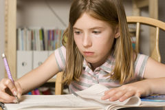 Study Time. Young girl studying at table Royalty Free Stock Images