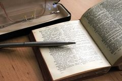 Study Time. Open Dictionary with Pen and Glasses stock photography