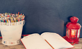 Study time = bucket of pencils, notebook and lamp. Bucket of pencils, notebook and lamp royalty free stock photo