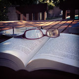 Study time. Reading glasses and book depicting a rest from reading Royalty Free Stock Photos