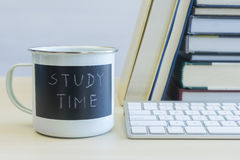 Study time words on mug with keyboard and books Stock Photos