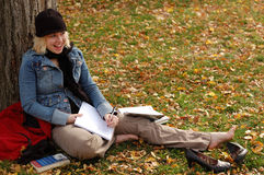 Study Woman. Beautiful young woman studying outdoors in Fall Royalty Free Stock Image