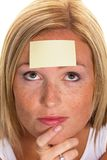 Study on women with Notepad. A young woman with a notepad on forehead Stock Photos