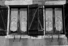 Study of wooden windows with lace, black and white. Royalty Free Stock Image