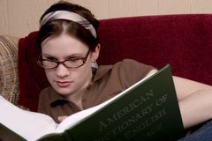Studying. Attractive teen studying on the couch Royalty Free Stock Photography