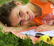 Studying. Young female student is preparing for exam. Primary focus on her face royalty free stock photo