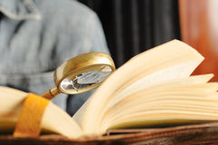 Studying. Education background with selective focus on magnifying glass Royalty Free Stock Image