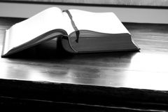 Studying. Open book on desk, bw stock photos
