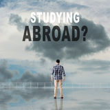Studying Abroad?. Text on the sky Royalty Free Stock Images
