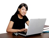 Studying African American girl. A young adult African American woman studying and working on laptop over white Royalty Free Stock Photos