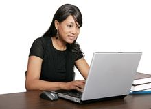 Studying African American girl. A young adult African American woman studying and working on laptop over white Stock Photos
