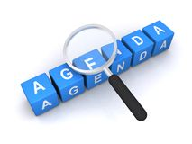 Studying the agenda. Text 'agenda' inscribed in white uppercase letters on small blue cubes with hand magnifier on top, concept of studying the agenda, white royalty free stock photo