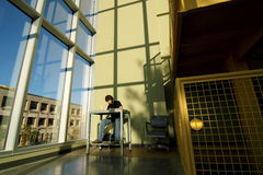 Studying alone in stairwell Stock Image