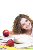 Studying in the bed. Pretty girl is studying in the bed. Isolated royalty free stock photography